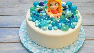 עוגת יום הולדת-ילדה בים ממתקים תכול, מתוך